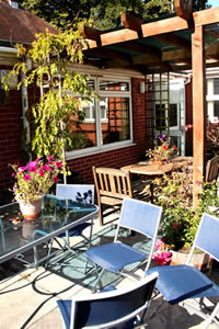 Outside patio area, perfect for relaxing on a sunny day