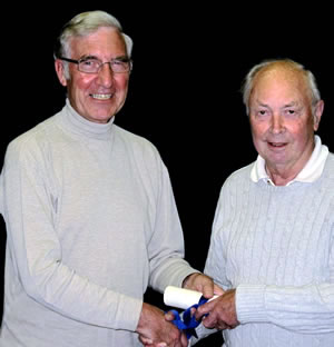 Tony Cole (left) handing the scroll of Life Vice Chairman to Jim Eastaugh