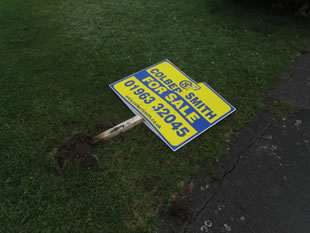 "A broken Colbert Smith ""For Sale"" sign"