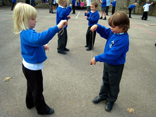 Horsington Primary School chrildren playing conkers