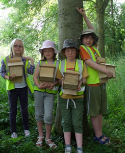 Children with nest boxes