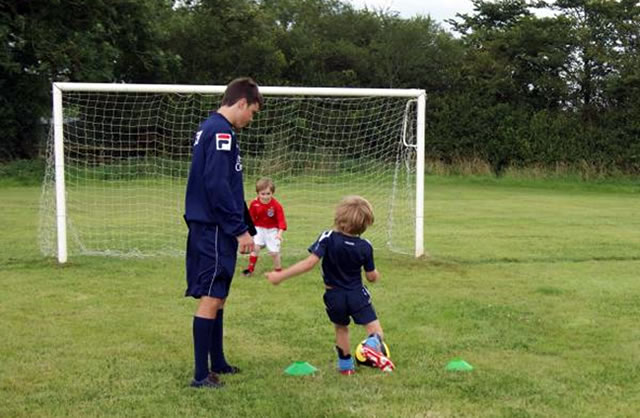 Young soccer players being coached