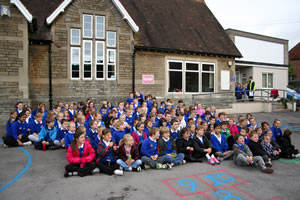 Wincanton Primary School children sitting out on the playground