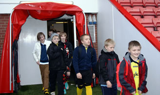 Walking through the players tunnel