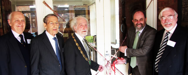 David Heath MP cutting that ribbon, this time from a slightly different angle.