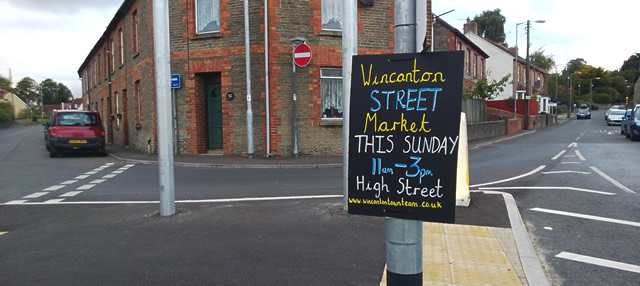 Wincanton Street Market chalk sign, on the roundabout at the bottom of South Street