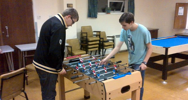 Teenagers playing table football at Wincanton Youth Club