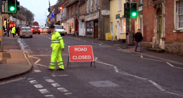 A steward setting up the 'Road Closed' sign for last year's Extravaganza