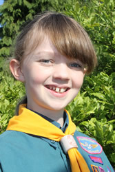 Alice Macey, age 11, invested in the 2nd Templecombe Scout Group