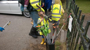 Participants equiping themselves with litter-pickers and high-vis jackets