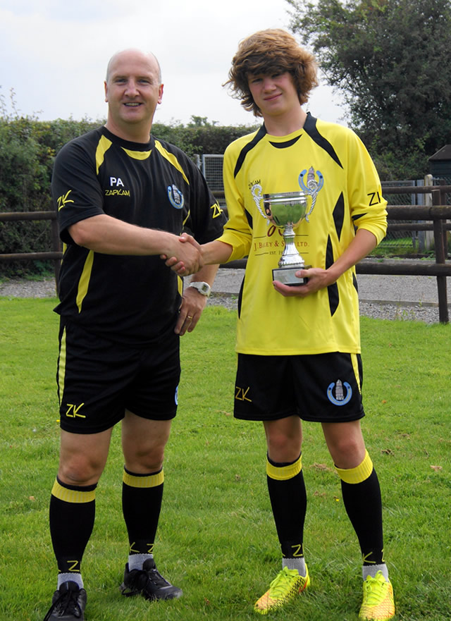 Harry Warwick being presented the Manager's Player Award by under 14s coach Phil Appleby