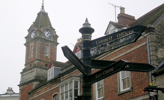 Wincanton Town Hall clock tower and Market Place signpost