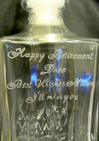 Hand-engraved glass bottle