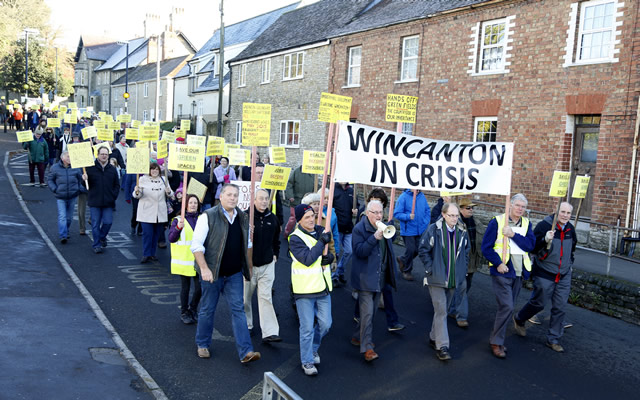 Wincanton in Crisis protest march proceeding down South Street