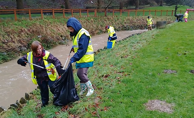 Volunteers picking litter on the banks of the River Cale, Wincanton