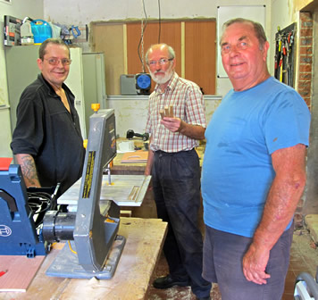 These shedders have used special equipment to make three small pieces of wood