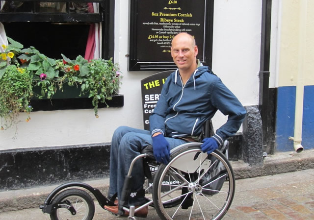 Andy Hall with his wheelchair specially adapted to cope with the cobbles and slopes of streets in the south west.