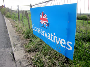 The Conservatives sign attached to the security fence at the Bayford Hill development site