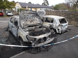 Burnt cars in Wincanton Memorial Hall car park, from a different angle