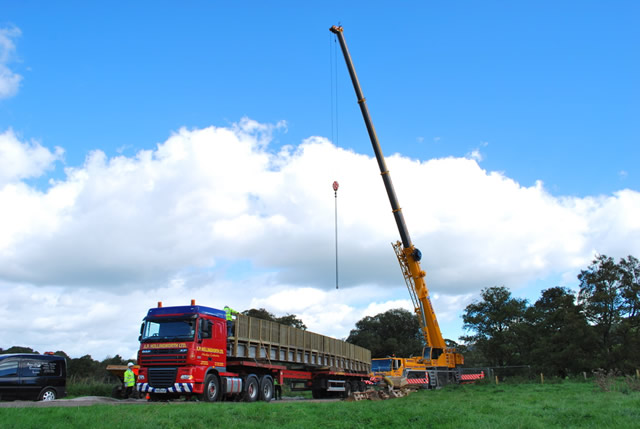 The articulated lorry and crane that will be delivering the new footbridge to Cale Park