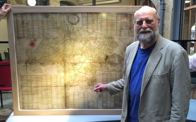 Photo by Joss Mullinger: Prof. Will Vaughan standing with the oldest known map of Castle Cary and Ansford