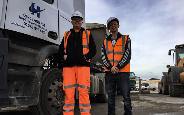 Matthew and Christian standing next to a Hopkins Concrete lorry