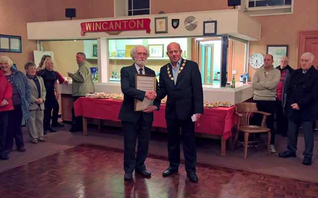 Colin Winder being presented the Wincanton Town Council's Community Award for 2016 by Mayor Howard Ellard