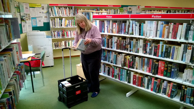 Pam Golding choosing books from Wincanton Library for her Home Library Service subscribers