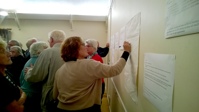 Attendees were invited to write feedback and suggestions on the walls