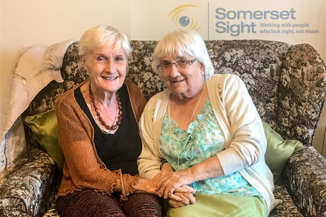 A Somerset Sight volunteer with her friend who suffers from sight loss