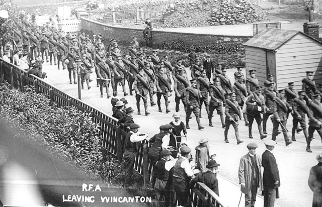 Soldiers of the Royal Field Artillery marching down to Wincanton Station to leave for the front in the First World War.