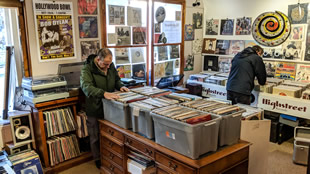 Customers browsing the vinyl at Highstreet Records, Wincanton