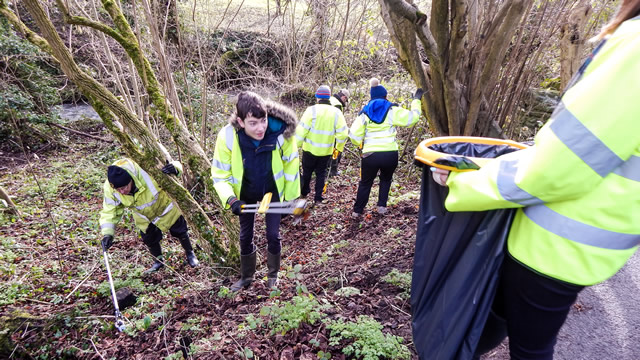 Picking litter from the banks of the River Cale in Wincanton