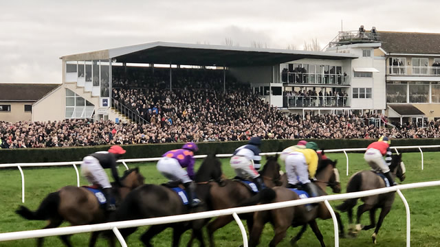 Racers passing by the grandstand at Wincanton Racecourse