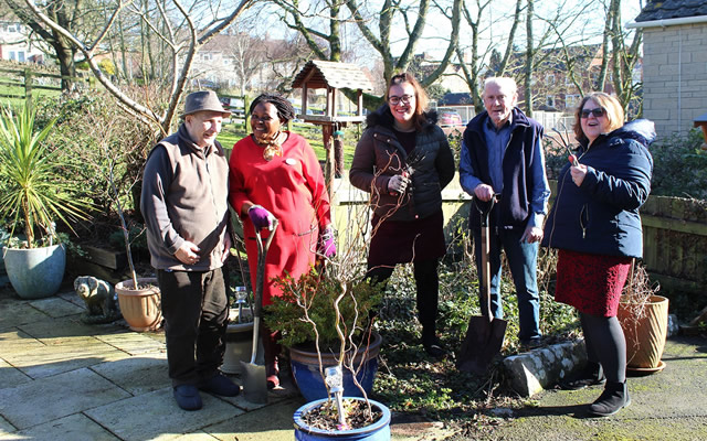 Carrington House staff and residents out in the garden
