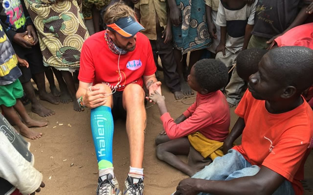 Brendan Rendall with children in Malawi