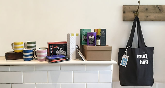 A Treatment Bag hanging on a hook, with its contents displayed on a mantelpiece