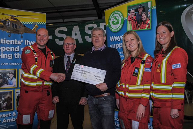 Lee Osborne and Kevin Aldred making a donation of £1200 to Dorset and Somerset Air Ambulance as part of the Lodges Charity for 2018