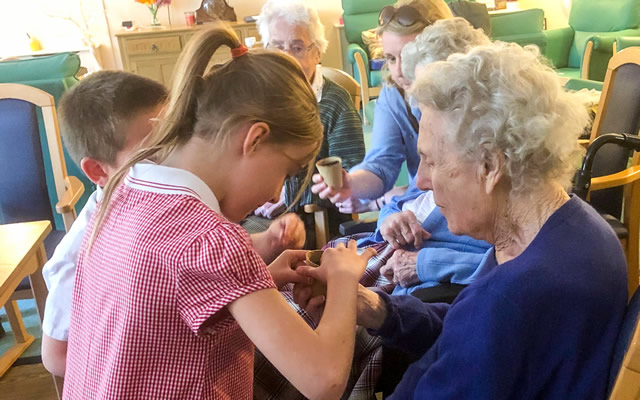 Our Lady's pupils potting plants with residents of Carrington House, Wincanton