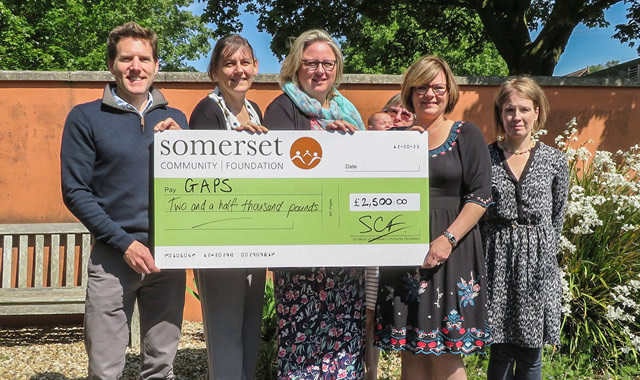Simon Whitehead from Myakka & Kirsty Campbell from SCF present the £2,500 cheque to Sammie Peckover, Angela England (just visible), Liz Morley & Sian Reddick from GAPS