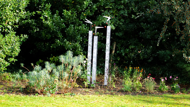 A wind-reactive pillar sculpture in the garden of the Greening the Earth gallery in Wincanton