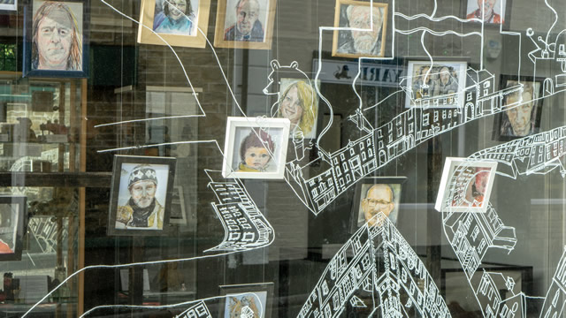 Portraits of local people in the window of the Greening the Earth gallery, Wincanton