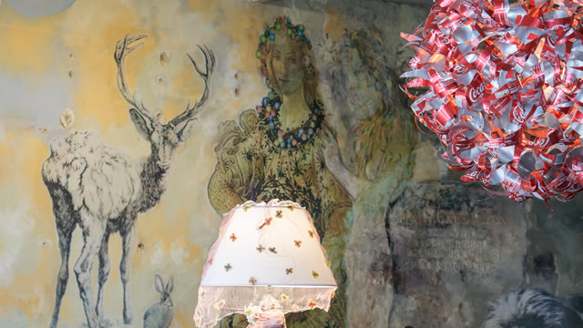 Murals and the aluminium can lamp shade at the Greening the Earth gallery in Wincanton