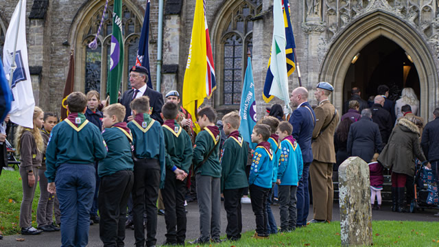 Wincnaton's 2019 Remembrance Parade flag bearers at the entrance of the Parish Church of St. Peter & St. Pauls