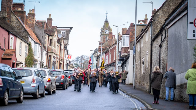 Wincanton's 2019 Remembrance Parade marching down Church Street led by Wincanton Silver Band