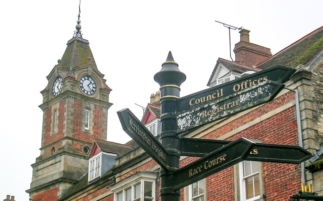Wincanton Market Place signpost, with the clock tower in the background