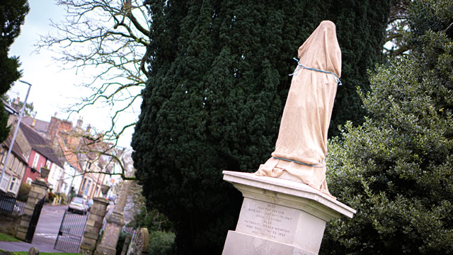The newly restored statue of Nethaniel Ireson in the grounds of Wincanton Parish Church, still covered