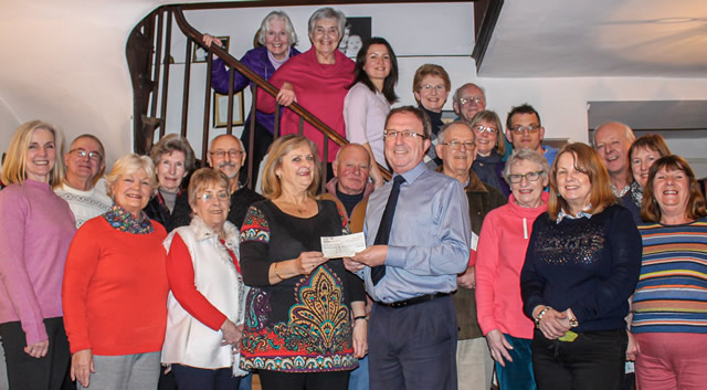 The Pilgrim Singers present a cheque for £1000 to the CAT Bus