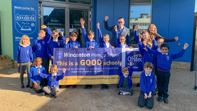 Wincanton Primary School staff and pupils celebrate a GOOD report from Ofsted