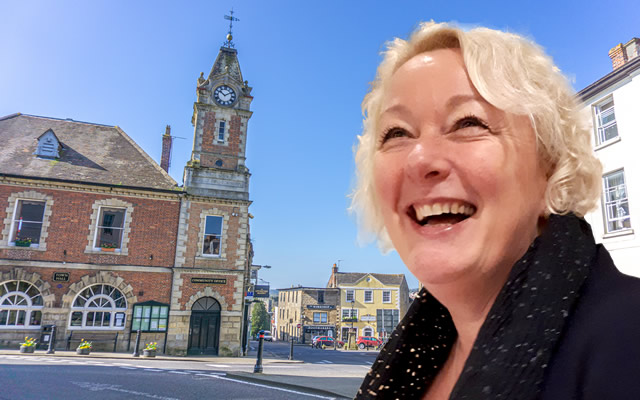 Councillor Sue Shelbourn-Barrow, superimposed in front of Wincanton Town Hall and Market Place